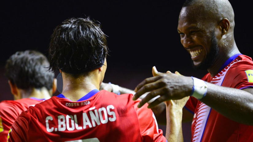 Bolanos and Waston celebrating with Costa Rica