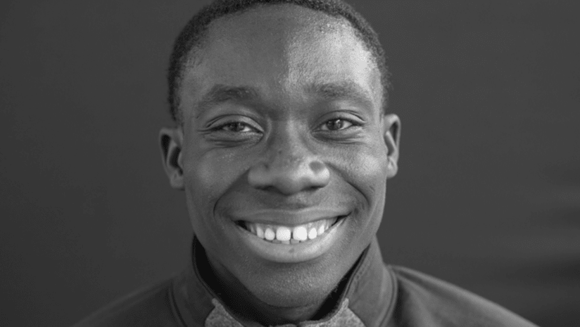 Alphonso Davies - closeup - portrait - black and white - smiling