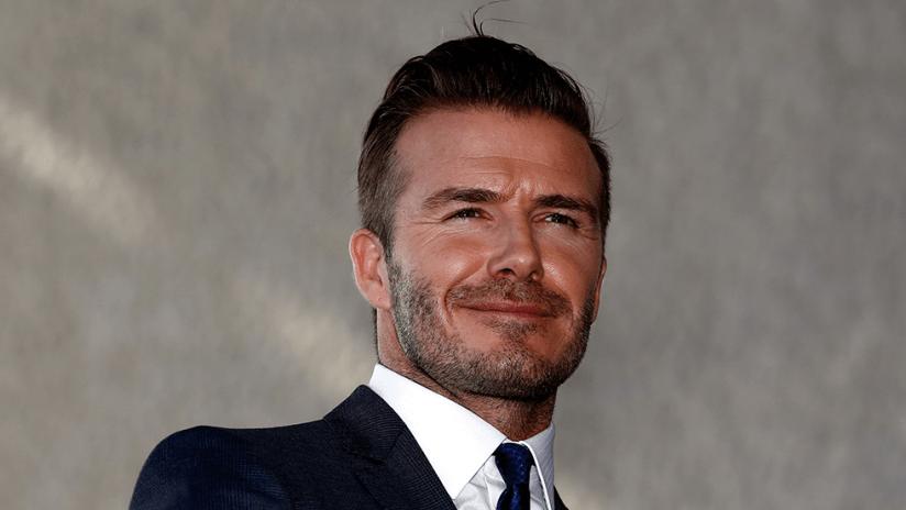 David Beckham - smiling - business suit