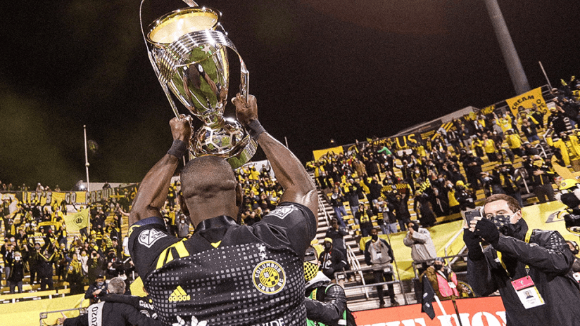 MLS Cup - 2020 - crew players present trophy to supporters group