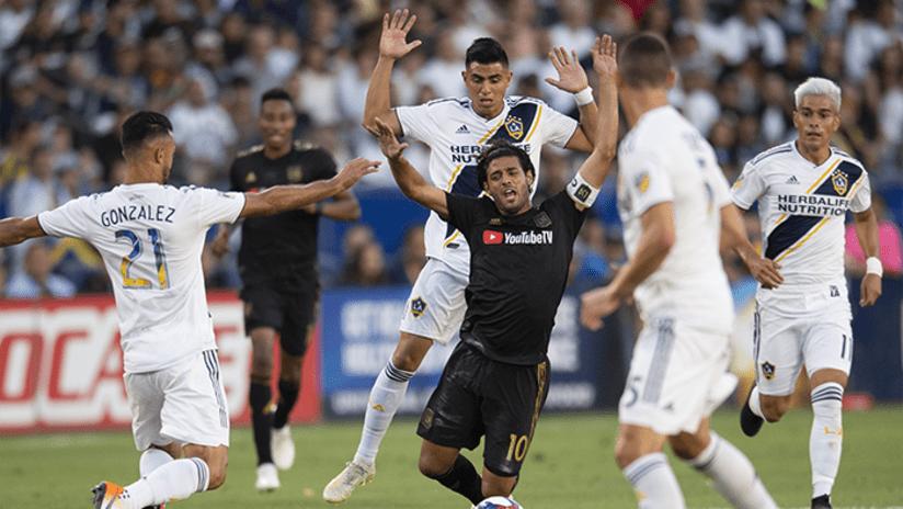 El Trafico - July 2019 - Carlos Vela surrounded by LA Galaxy players