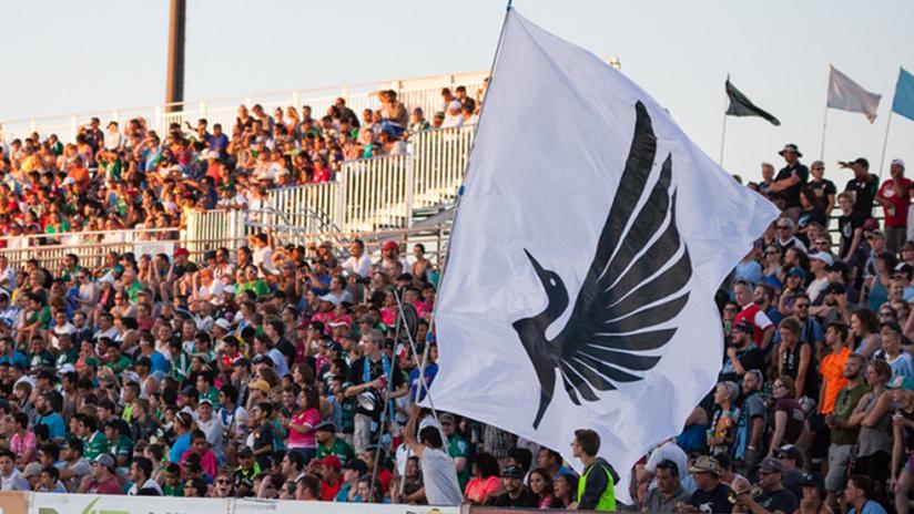 Minnesota United - crowd with loon flag waving