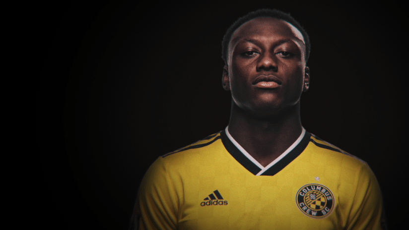 Derrick Etienne Jr - portrait against black background - use only for special posts