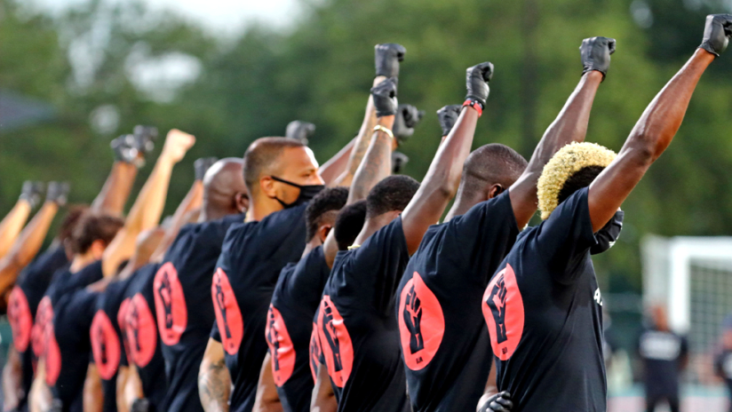 Black Players for Change - fists up back to camera