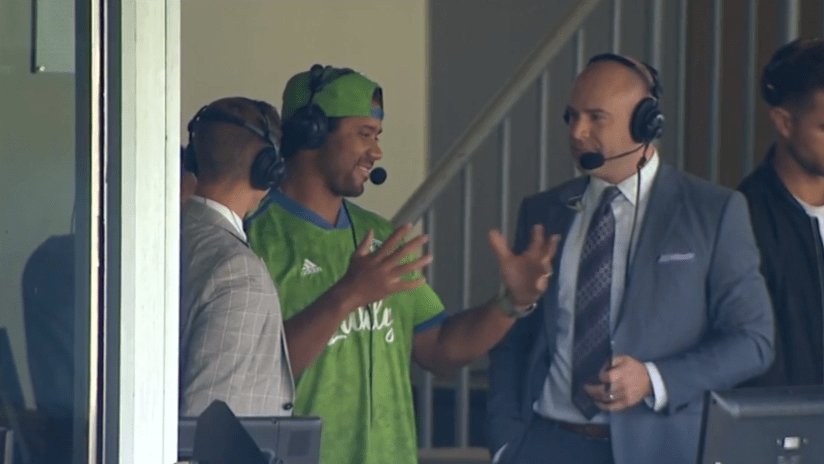 Russell Wilson - Seattle Sounders - THUMB ONLY - part-owner in FOX booth with Holden, Strong