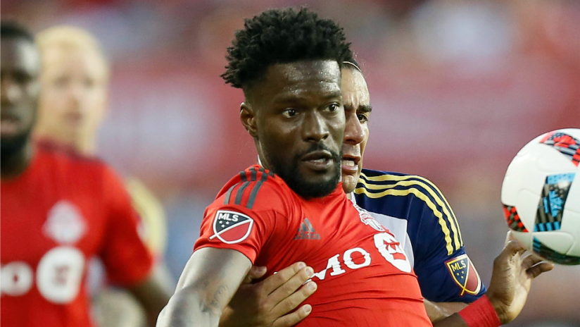 Tosaint Ricketts - Toronto FC - tries to bring a ball down with a defender on his back