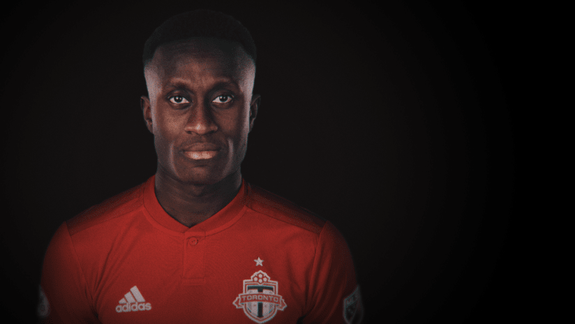 Richie Laryea - portrait against black background - use only for special posts