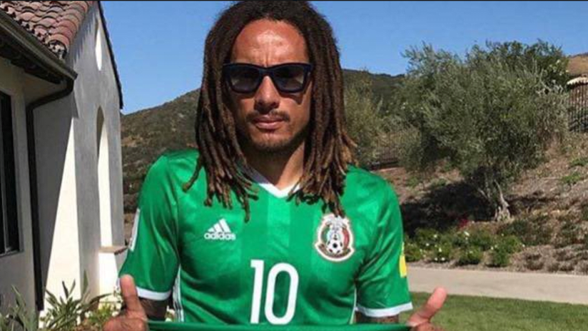 THUMB ONLY: Jermaine Jones wearing/holding up Mexico jerseys