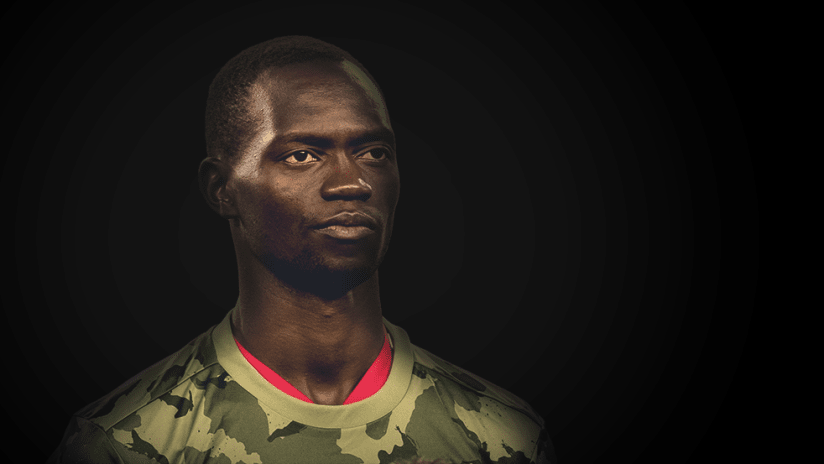 Micheal Azira - portrait against black background - use only for special posts