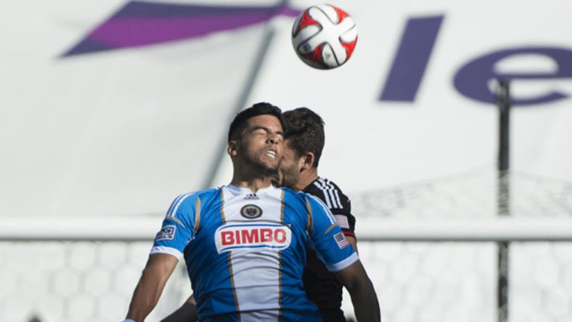 Pedro Ribeiro goes up for a header