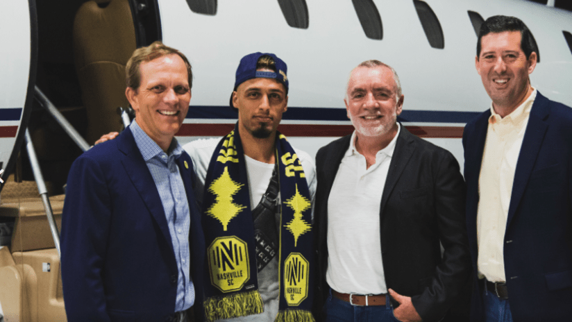Hany Mukhtar poses with Mikes Jacos, Ian Ayre - Nashville SC