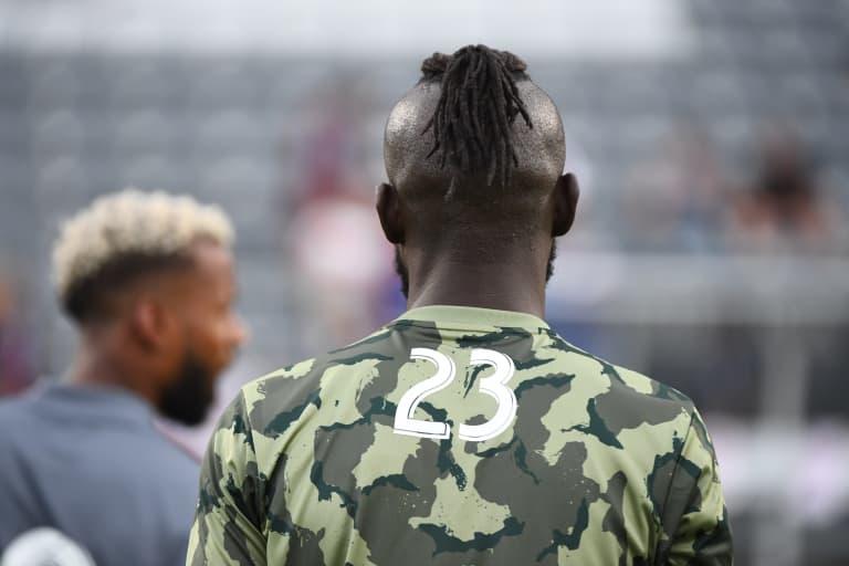 Bid on player-worn camouflaged warmup tops  -