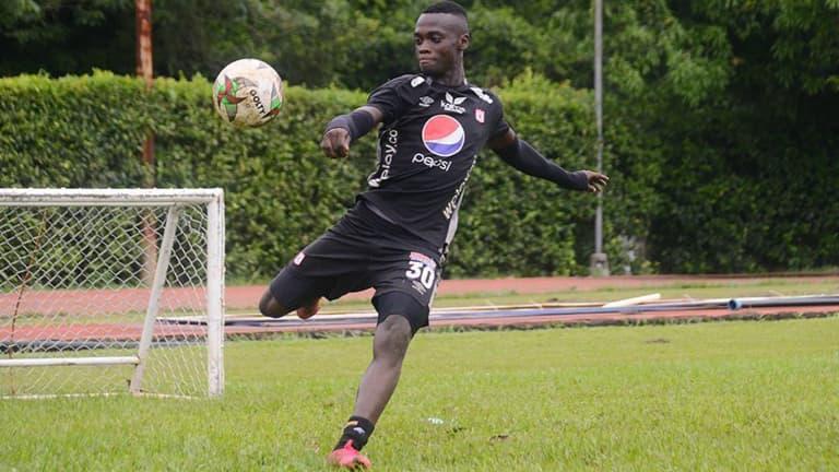 Santiago Moreno executes a volley while training with América de Cali in Colombia.