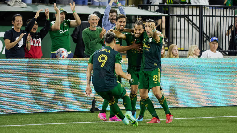 Felipe Mora celebrates his game-winning goal with teammates during the Portland Timbers' victory over LAFC (July 21, 2021)