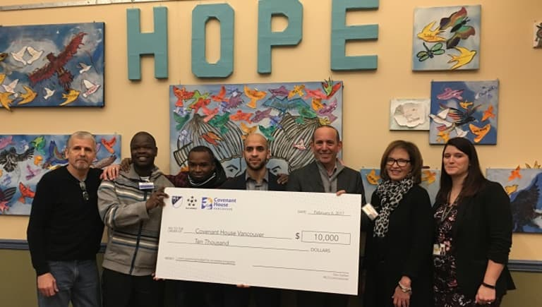 MLS Commissioner Don Garber visits Covenant House Vancouver to donate $10,000 -