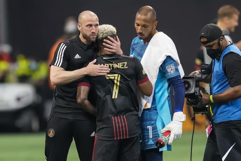 Rob Valentino hugs Josef Martinez