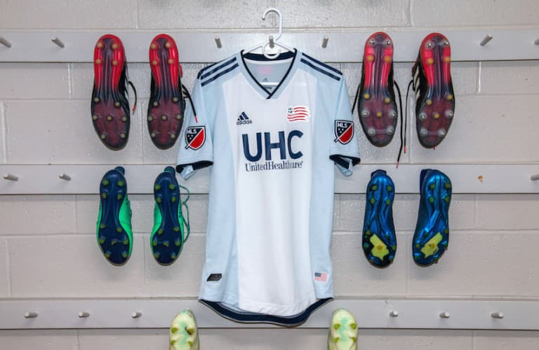 New England Revolution unveil new secondary jersey for 2019 season - https://league-mp7static.mlsdigital.net/elfinderimages/2019%20Kit%20Drops%20-%20NE%20-%20Jersey%20with%20Cleats.jpg
