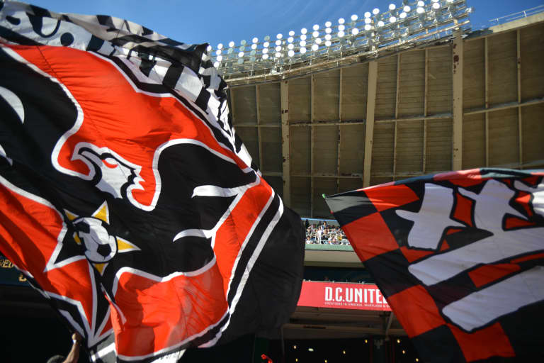D.C. supporters wave flags under RFK's swooping roof