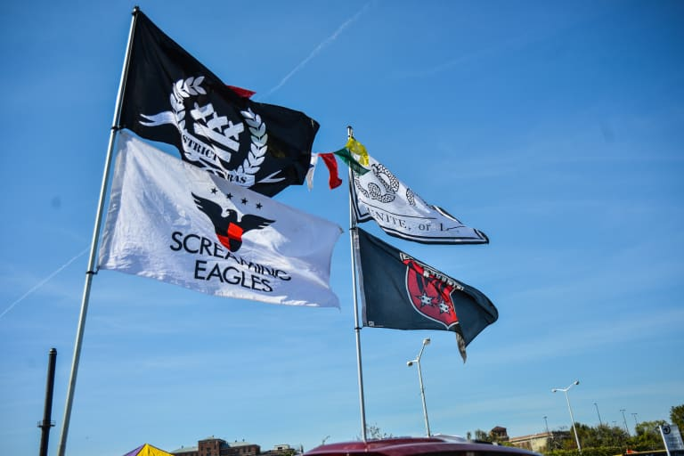 Flags flap at the Lot 8 tailgate at RFK