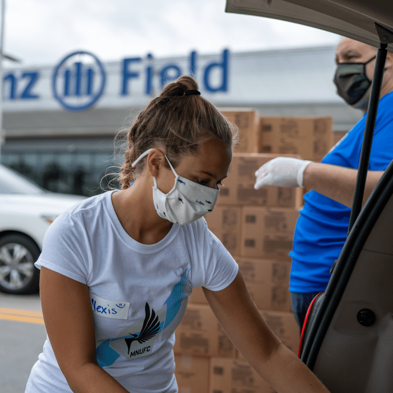 MNUFC + Partners Deliver Food To Midway -