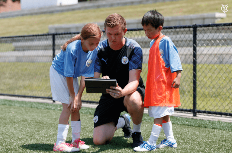 NYCFC x Manchester City Summer Camp - https://newyorkcity-mp7static.mlsdigital.net/elfinderimages/Pictures/Camp/Man%20City%20Photo%203.PNG