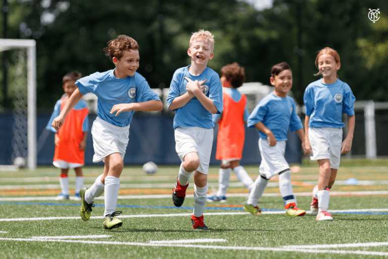 NYCFC x Manchester City Summer Camp - https://newyorkcity-mp7static.mlsdigital.net/elfinderimages/Pictures/Camp/Man%20City%20Photo%201.PNG