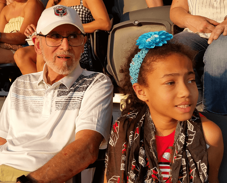 Mike Basileo, a 25-year D.C. United supporter, in the Audi Field seats he holds with his family.