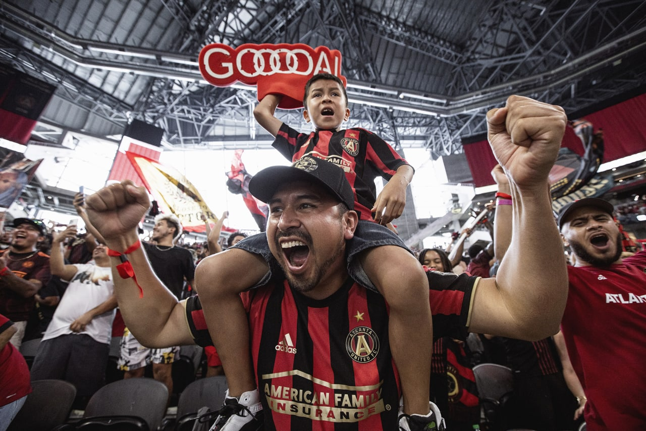 Atlanta United supporters cheer after a goal during the match against D.C. United at Mercedes-Benz Stadium in Atlanta, Georgia on Saturday September 18, 2021. (Photo by Matthew Grimes/Atlanta United)