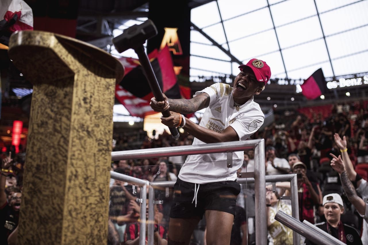 Atlanta Dream player Courtney Williams hits the golden spike before the match against Cincinnati FC at Mercedes-Benz Stadium in Atlanta, Georgia on Wednesday September 15, 2021. (Photo by Kyle Hess/Atlanta United)