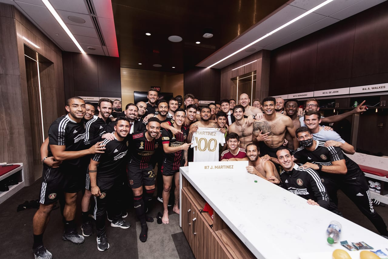 Atlanta United forward Josef Martinez #7 poses with the team after his 100th club goal in the locker room after the match against Inter Miami at Mercedes-Benz Stadium in Atlanta, Georgia on Wednesday September 29, 2021. (Photo by Jacob Gonzalez/Atlanta United)