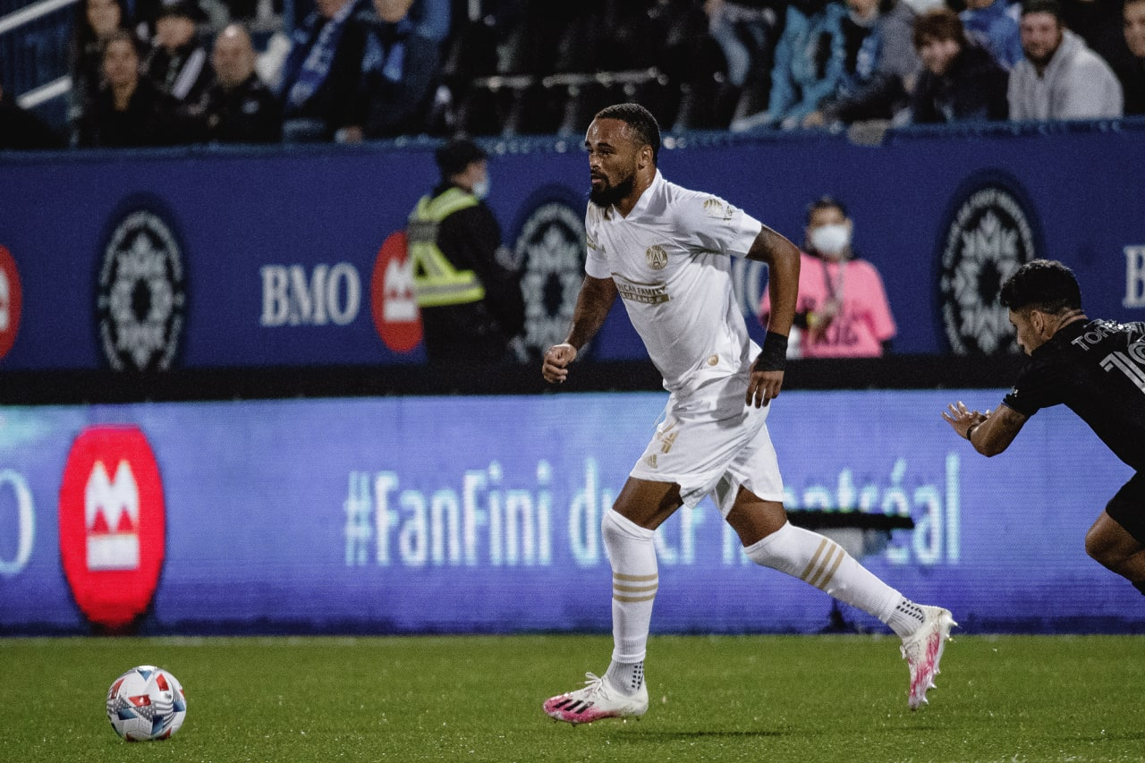 Atlanta United defender Anton Walkes #4 dribbles the ball during the first half of the match against CF Montréal at Stade Saputo in Montreal, Quebec, on Saturday October 2, 2021. (Photo by Audrey Magny/Atlanta United)