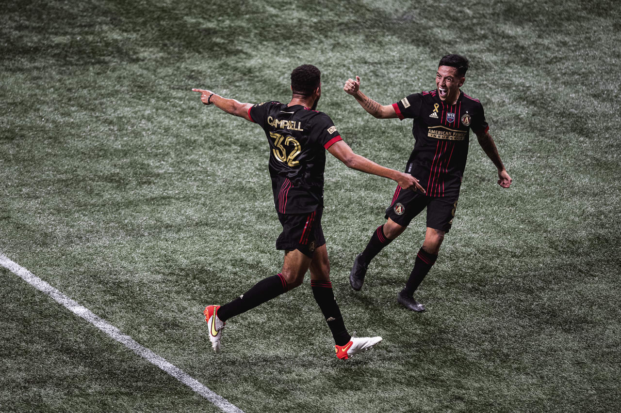 Atlanta United defender George Campbell #32 celebrates with midfielder Ezequiel Barco #8  after scoring his first goal during the match against Orlando City at Mercedes-Benz Stadium in Atlanta, Georgia on Friday September 10, 2021. (Photo by AJ Reynolds/Atlanta United)