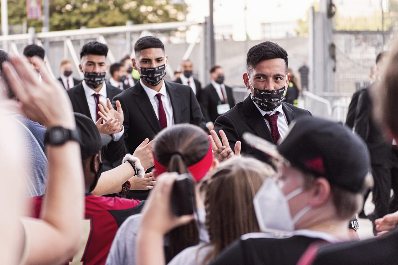 Atlanta United midfielder Ezequiel Barco #8 high fives supporters upon arrival before the match against Orlando City at Mercedes-Benz Stadium in Atlanta, Georgia on Friday September 10, 2021. (Photo by Mitchell Martin/Atlanta United)