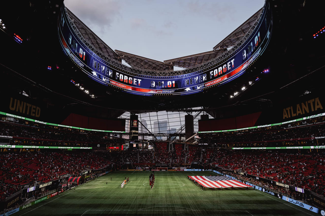 A wide stadium shot during a moment of silence for 9/11 before the match against Orlando City at Mercedes-Benz Stadium in Atlanta, Georgia on Friday September 10, 2021. (Photo by Adam Hagy/Atlanta United)