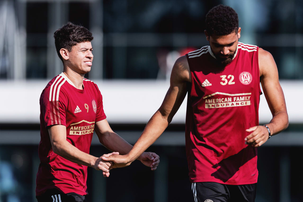 Atlanta United midfielder Matheus Rossetto #9 and defender George Campbell #32 high five during training at Children's Healthcare of Atlanta Training Ground in Marietta, GA, on Tuesday September 14, 2021. (Photo by Jacob Gonzalez/Atlanta United)