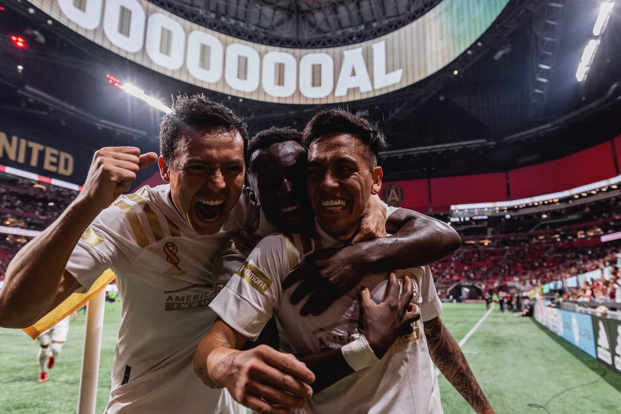 Atlanta United midfielder Ezequiel Barco #8 celebrates with defender George Campbell #32 and defender George Bello #21 after scoring a goal during the match against Cincinnati FC at Mercedes-Benz Stadium in Atlanta, Georgia on Wednesday September 15, 2021. (Photo by Jacob Gonzalez/Atlanta United)