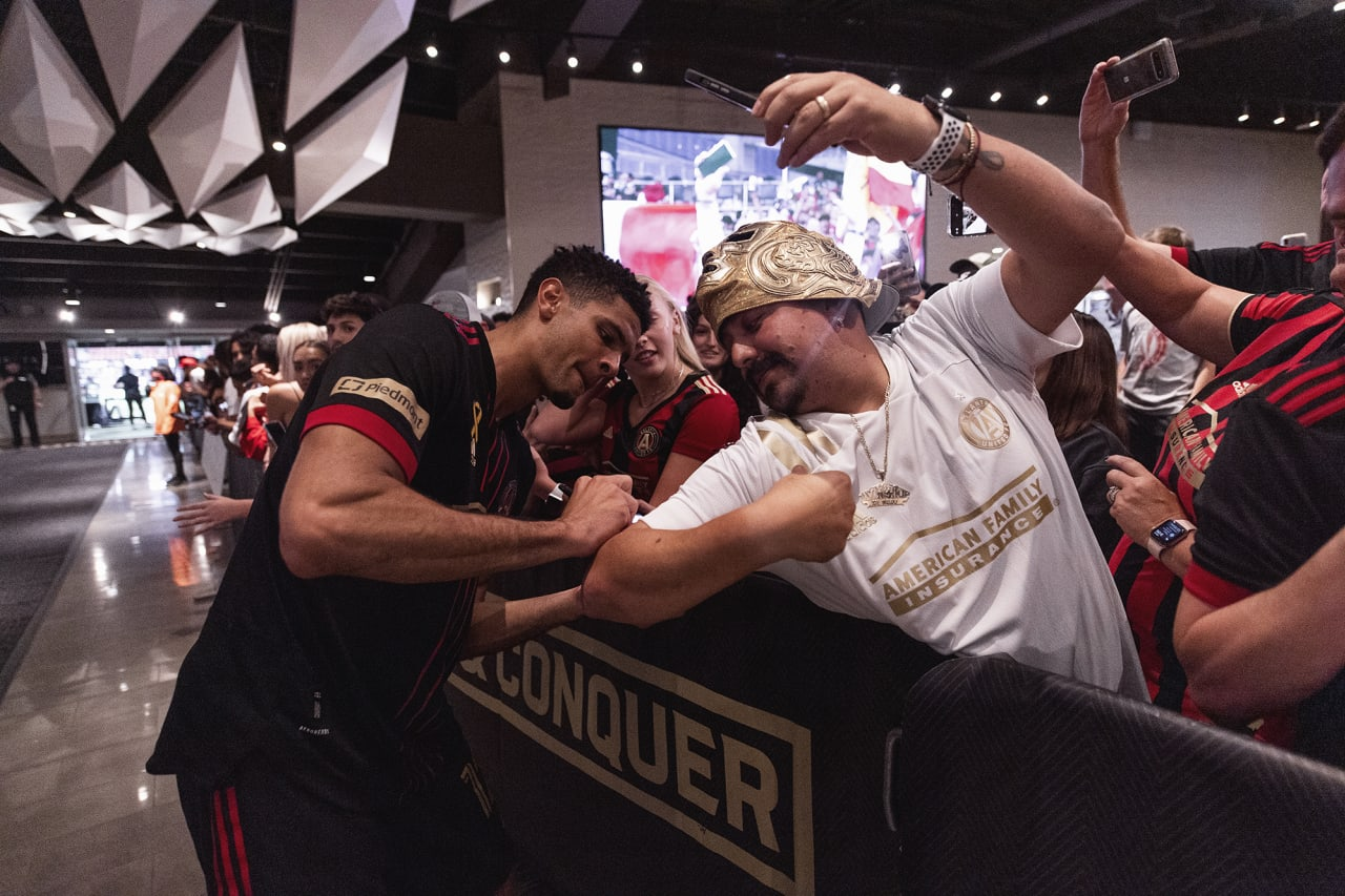 Atlanta United defender Miles Robinson #12 interacts with supporters after the match against Inter Miami at Mercedes-Benz Stadium in Atlanta, Georgia on Wednesday September 29, 2021. (Photo by Dakota Williams/Atlanta United)