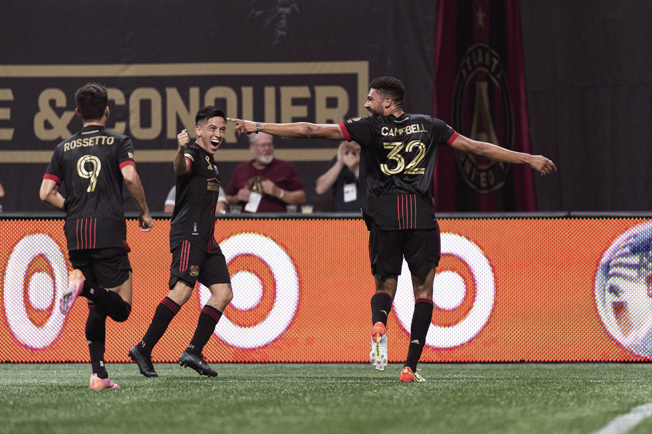 Atlanta United defender George Campbell #32 celebrates with midfielder Ezequiel Barco #8  after scoring his first goal during the match against Orlando City at Mercedes-Benz Stadium in Atlanta, Georgia on Friday September 10, 2021. (Photo by Jacob Gonzalez/Atlanta United)