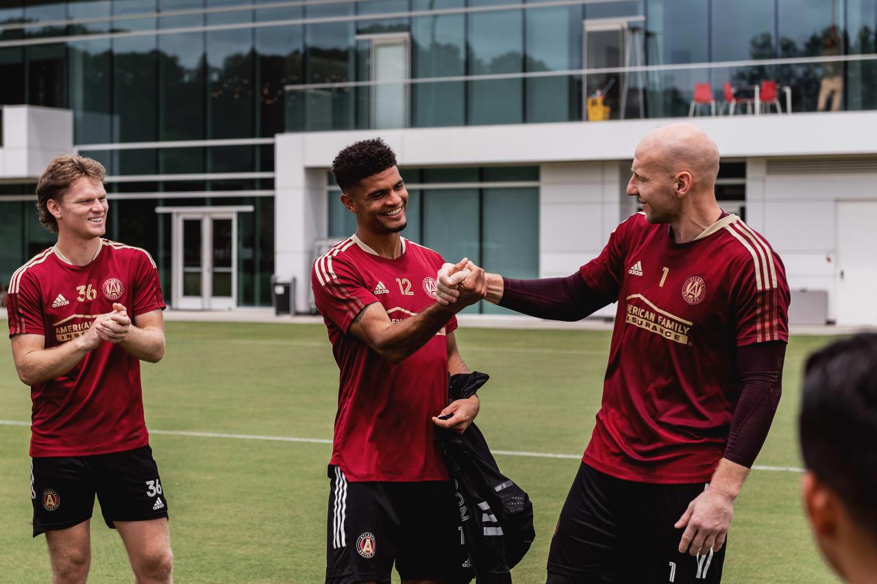 Teammate Brad Guzan (right) congratulates Robinson