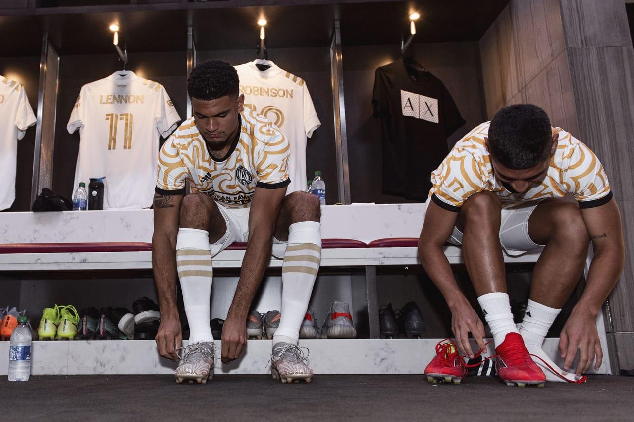 Atlanta United defender Miles Robinson #12 prepares in the locker room before the match against Cincinnati FC at Mercedes-Benz Stadium in Atlanta, Georgia on Wednesday September 15, 2021. (Photo by Jacob Gonzalez/Atlanta United)