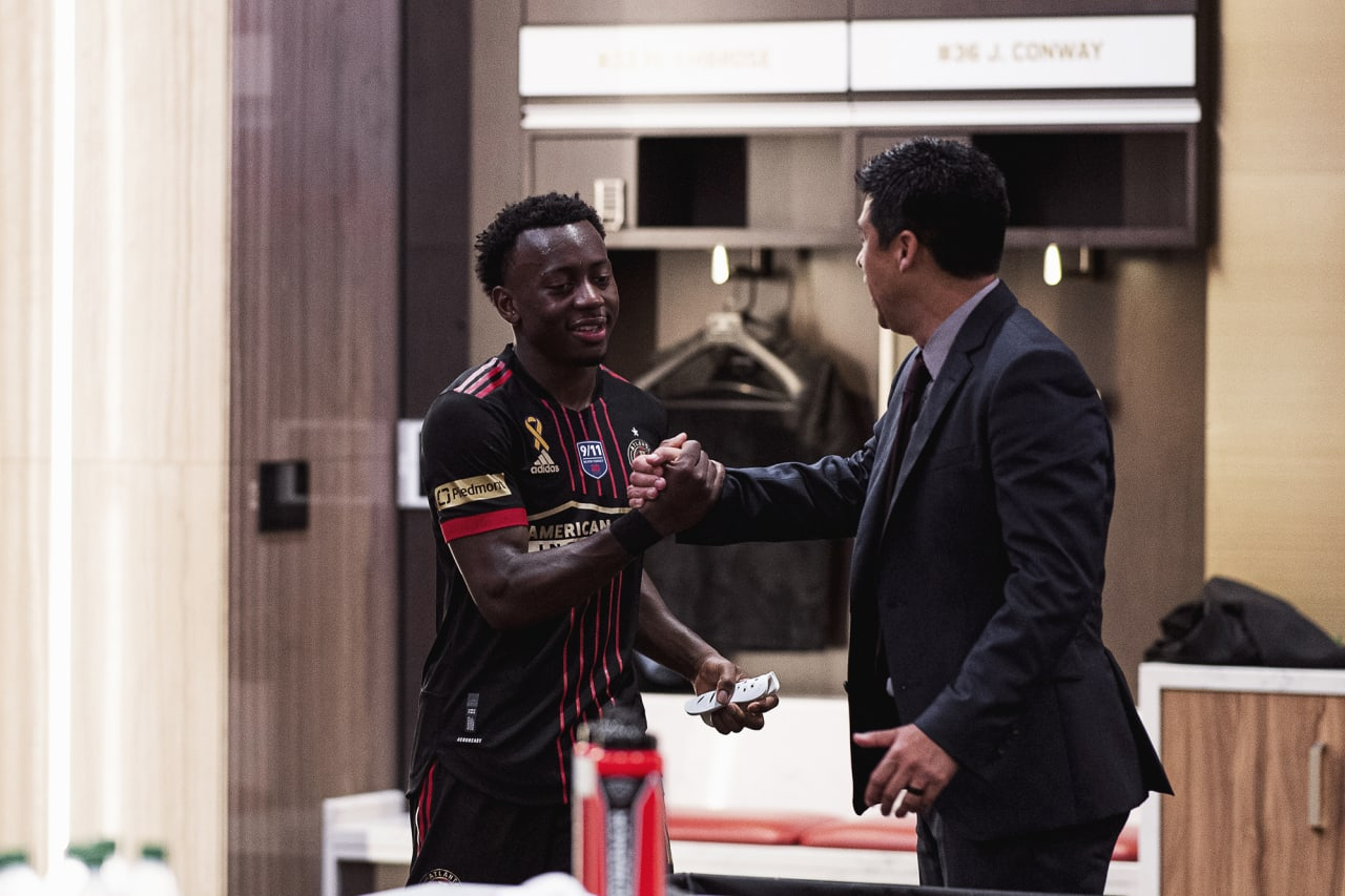 Atlanta United defender George Bello #21 celebrates with Head Coach Gonzalo Pineda in the locker room after the match against Orlando City at Mercedes-Benz Stadium in Atlanta, Georgia on Friday September 10, 2021. (Photo by Jacob Gonzalez/Atlanta United)