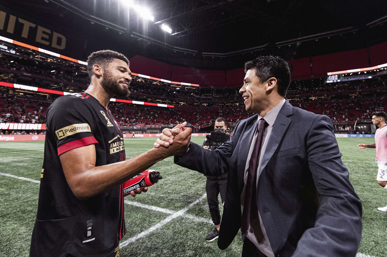 Atlanta United defender George Campbell #32 celebrates with Head Coach Gonzalo Pineda after the match against Orlando City at Mercedes-Benz Stadium in Atlanta, Georgia on Friday September 10, 2021. (Photo by Jacob Gonzalez/Atlanta United)