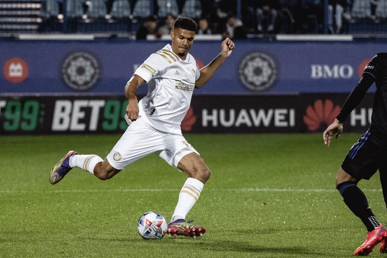 Atlanta United defender Miles Robinson #12 kicks the ball during the first half of the match against CF Montréal at Stade Saputo in Montreal, Quebec, on Saturday October 2, 2021. (Photo by Audrey Magny/Atlanta United)