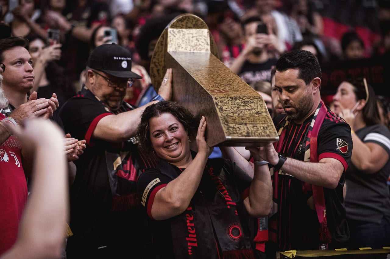Atlanta United supporters carry the golden spike before the match against Inter Miami at Mercedes-Benz Stadium in Atlanta, Georgia on Wednesday September 29, 2021. (Photo by Adam Hagy/Atlanta United)