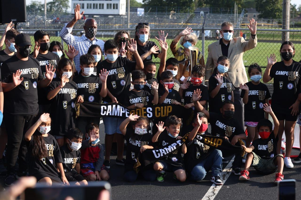Children, Crew, and OHC celebrate the facility