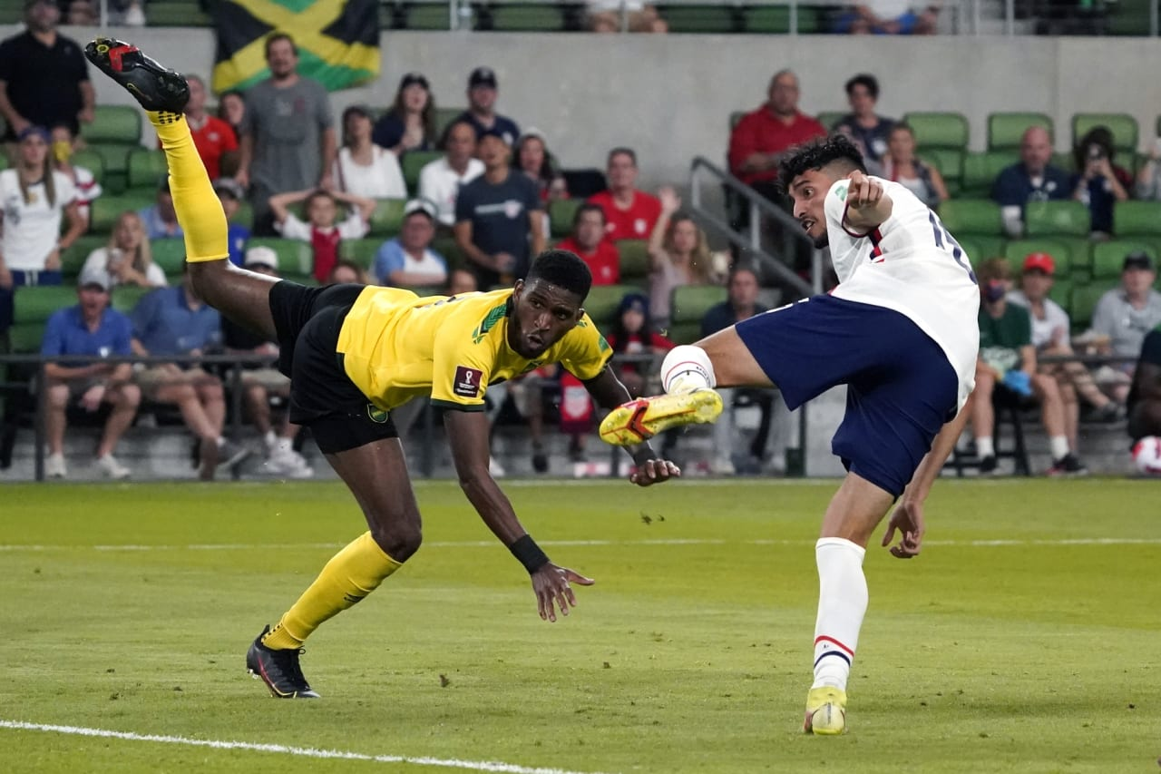 Oct 7, 2021; Austin, Texas, USA; United States forward Ricardo Pepi (16) watches his goal past Jamaica defender Damion Lowe (left) during the second half of a FIFA World Cup Qualifier at Q2 Stadium. Mandatory Credit: Chuck Burton-USA TODAY Sports